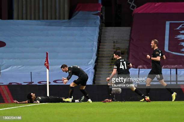 Jesse Lingard of West Ham United celebrates with team mates Aaron Cresswell, Declan Rice and Tomas Soucek after scoring their side's second goal...