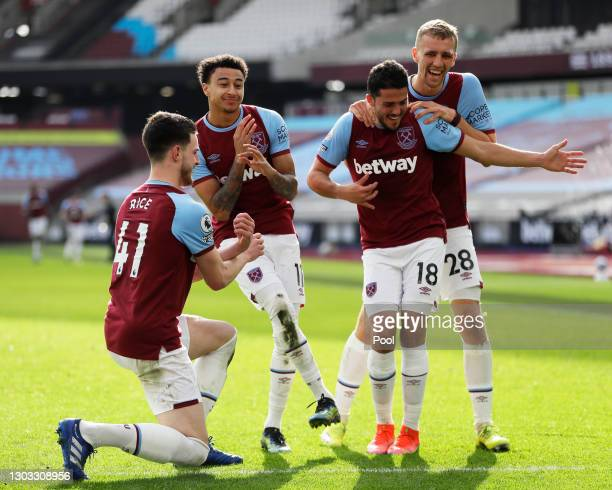Jesse Lingard of West Ham United celebrates with team mates Declan Rice, Pablo Fornals and Tomas Soucek after scoring their side's second goal during...