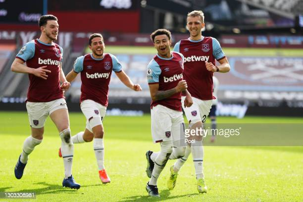 Jesse Lingard of West Ham United celebrates with team mates Declan Rice and Tomas Soucek after scoring their side's second goal during the Premier...