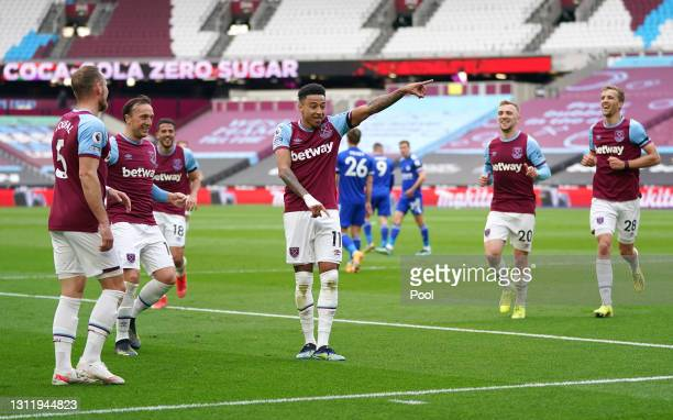 Jesse Lingard of West Ham United celebrates with teammates after scoring their team's first goal during the Premier League match between West Ham...