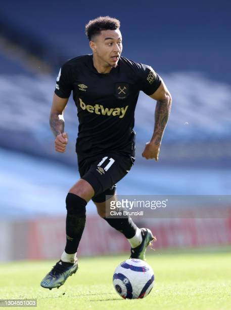 Jesse Lingard of West Ham United runs with the ball during the Premier League match between Manchester City and West Ham United at Etihad Stadium on...