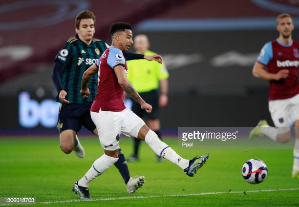 Jesse Lingard of West Ham United scores their side's first goal from a rebound off of Illan Meslier of Leeds United's penalty save during the Premier...