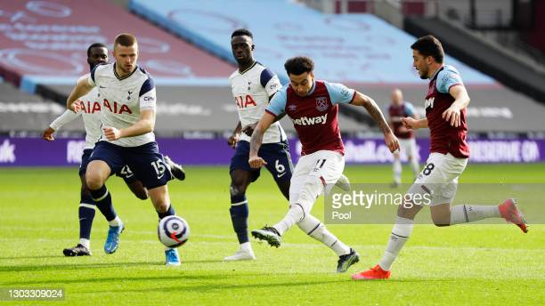 Jesse Lingard of West Ham United scores their side's second goal whilst under pressure from Eric Dier of Tottenham Hotspur during the Premier League...