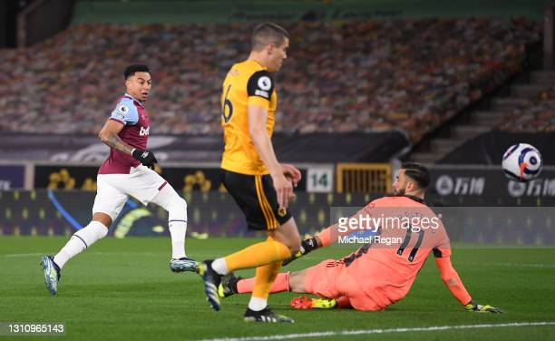 Jesse Lingard of West Ham United scores their team's first goal past Rui Patricio and Conor Coady of Wolverhampton Wanderers during the Premier...