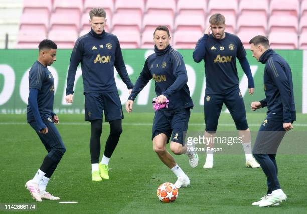 Jesse Lingard Scott McTominay Nemanja Matic Luke Shaw and Phil Jones of Manchester United in action during a training session ahead of their second...