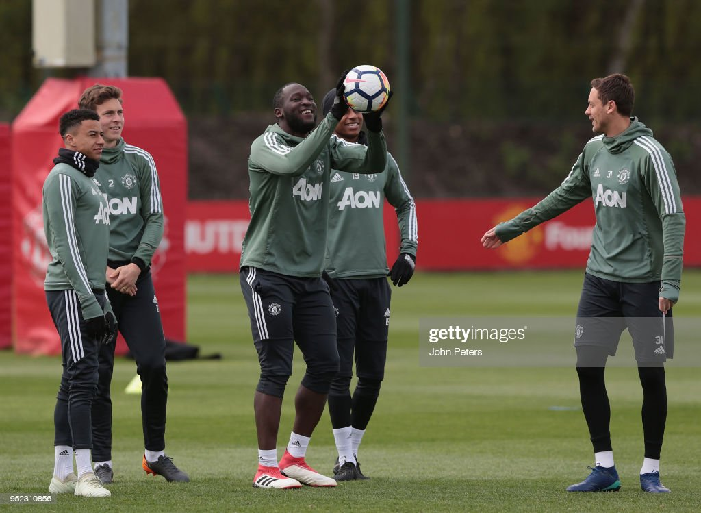 Jesse Lingard, Victor Lindelof, Romelu Lukaku and Nemanja Matic of Manchester United in action during a first team training session at Aon Training Complex on April 28, 2018 in Manchester, England.