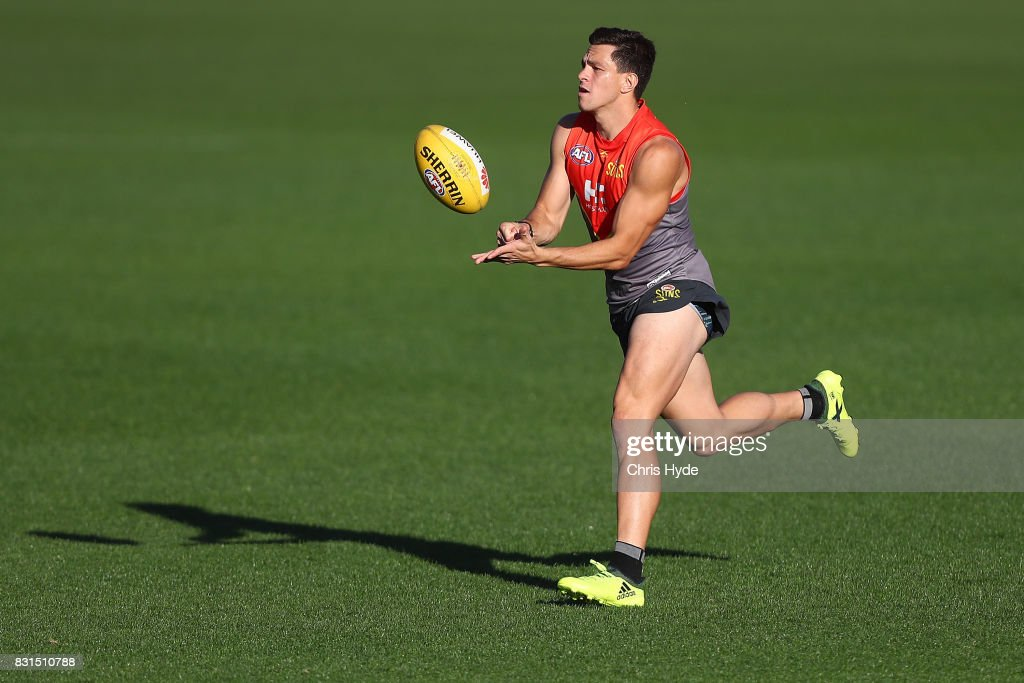 Jesse Lonergan handballs during a Gold Coast Suns AFL training session at Metricon Stadium on August 15, 2017 in Gold Coast, Australia.