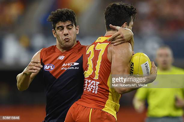 Jesse Lonergan of the Suns is tackled by Christian Petracca of the Demons during the round seven AFL match between the Gold Coast Suns and the...