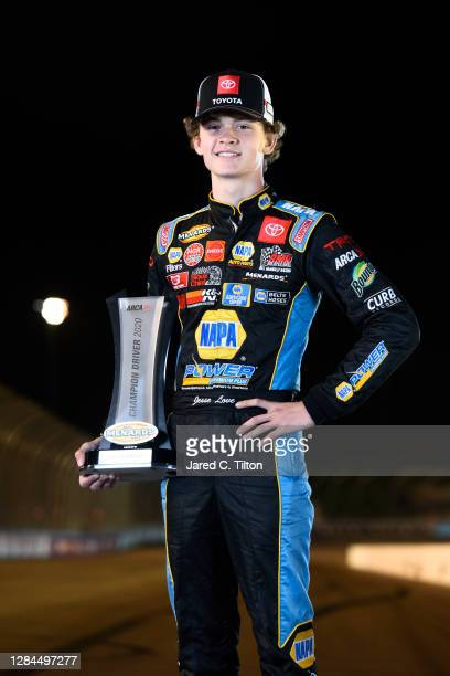 Jesse Love, driver of the NAPA Power Premium Plus Toyota poses for a photo with the ARCA Menards Series Championship trophy at Phoenix Raceway on...