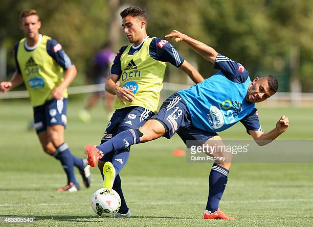 Jesse Makarounas and Andrew Nabbout of the Victory contest for the ball during a Melbourne Victory ALeague training session at Gosch's Paddock on...
