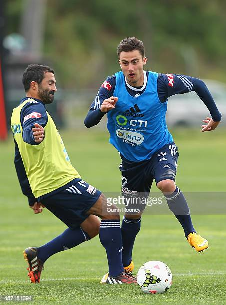 Jesse Makarounas of the Victory is tackled by Fahid Ben Khalfallah during a Melbourne Victory Training Session at Gosch's Paddock on October 14 2014...