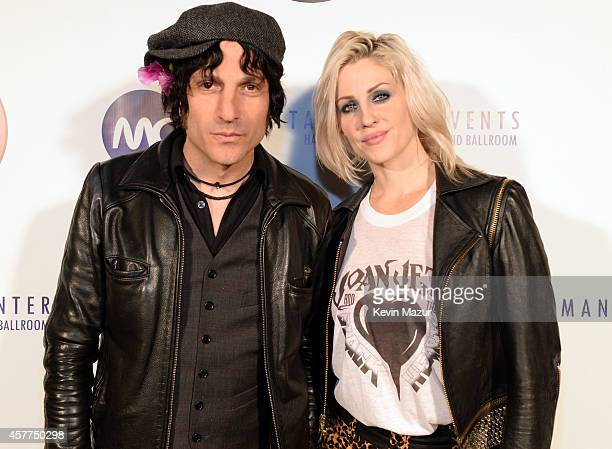 Jesse Malin and Brody Dalle backstage during The 6th Annual Little Kids Rock Benefit at Hammerstein Ballroom on October 23 2014 in New York City