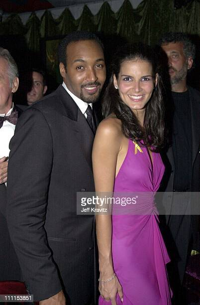 Jesse Martin and Angie Harmon during HBO Emmy Party at Spago in Beverly Hills California United States