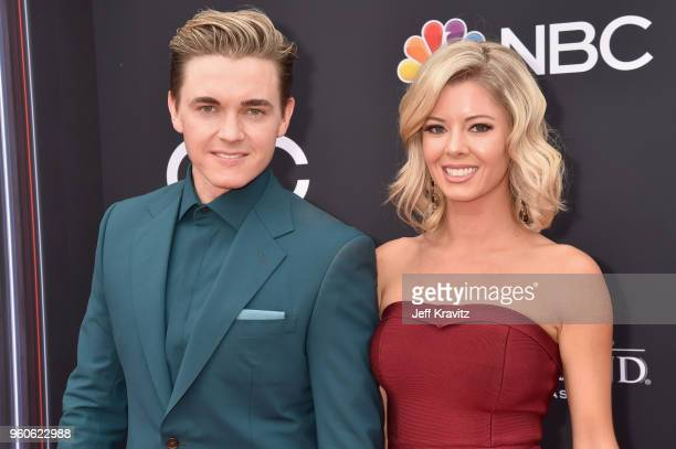 Jesse McCartney and Katie Peterson attend the 2018 Billboard Music Awards at MGM Grand Garden Arena on May 20 2018 in Las Vegas Nevada