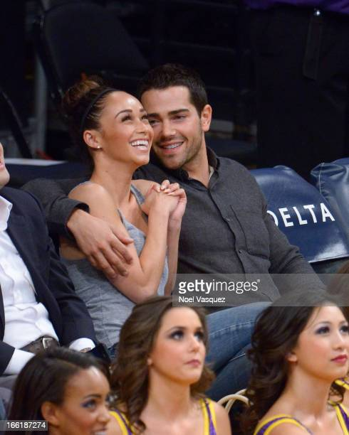 Jesse Metcalfe and Cara Santana attend a basketball game between the New Orleans Hornets and the Los Angeles Lakers at Staples Center on April 9 2013...