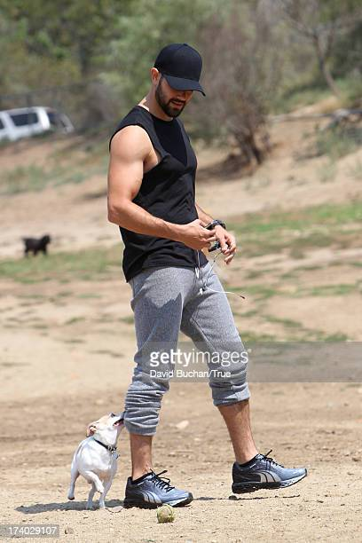 Jesse Metcalfe and his girlfriend Cara Santana are seen at a dog park July 19 2013 in Los Angeles California