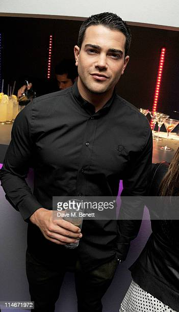 Jesse Metcalfe celebrates in the VIP Room at the launch of Sunglass Hut's new Covent Garden store on May 25 2011 in London England