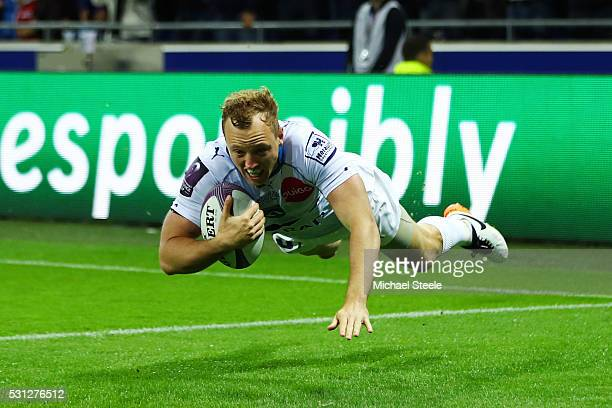 Jesse Mogg of Montpellier dives over to score the opening try during the European Rugby Challenge Cup Final match between Harlequins and Montpellier...