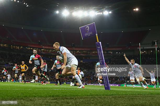 Jesse Mogg of Montpellier scores the opening try during the European Rugby Challenge Cup Final match between Harlequins and Montpellier at Stade de...