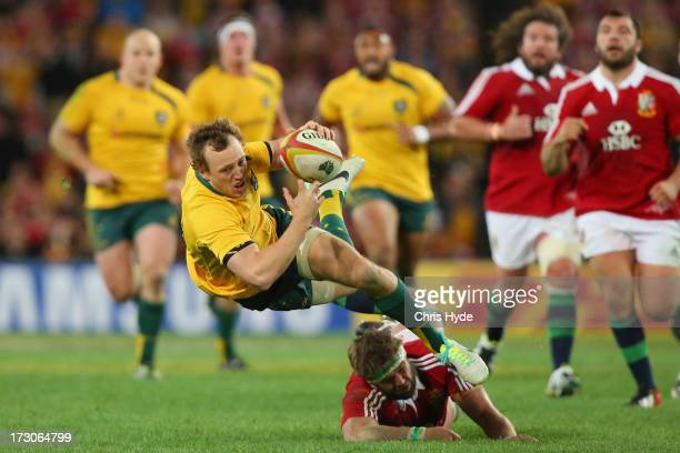 Jesse Mogg of the Wallabies is tackled by Geoff Parling of the British Irish Lions during the International Test match between the Australian...