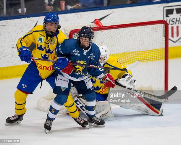 Jesse Moilanen of the Finland Nationals battles in front of the net with Jacob Olofsson of the Sweden Nationals during the 2018 Under18 Five Nations...
