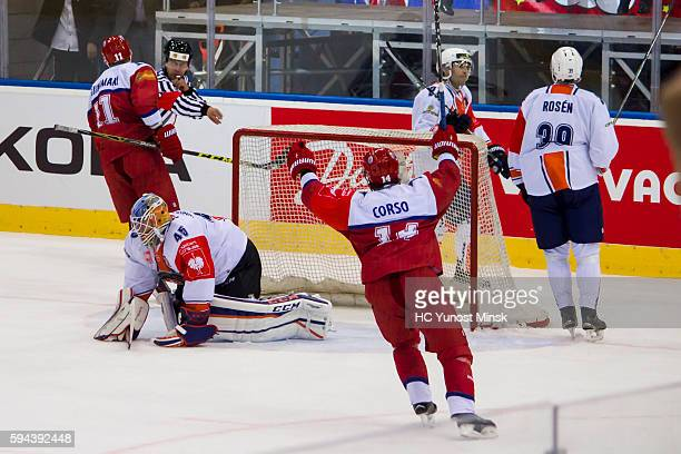 Jesse Niinimaki and Daniel Korso of YunostMinsk celebrate the decisive goal during the overtime of the Champions Hockey League group stage game...