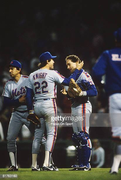 Jesse Orosco Ray Knight and Gary Carter of the New York Mets congratulate one another after a New York win during the World Series against the Boston...