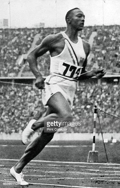 Jesse Owens at the end of the 100m at the Berlin Olympic Games 1936 Owens after winning one of his four gold medals at the games A print from Olympia...