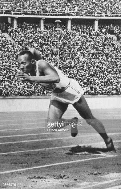 Jesse Owens of the USA at the start of the 200 metres at the 1936 Berlin Olympics which he won in 207 seconds an Olympic record He won three other...