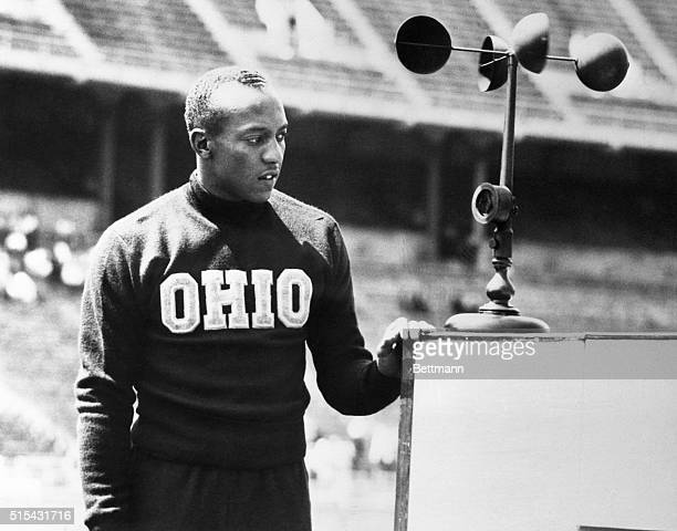 Jesse Owens Ohio State's ace sprinter is shown after breaking the world's record in the 220yard dash in the 36th annual Western Conference track and...