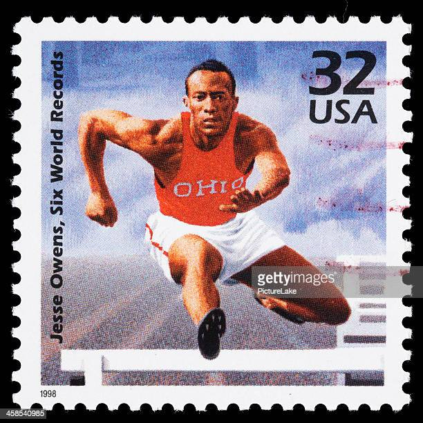 usa jesse owens postage stamp - jesse owens stock pictures, royalty-free photos & images