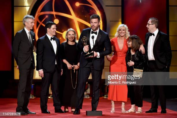 Jesse Palmer accepts the Outstanding Entertainment News Program award for 'DailyMailTV' with cast and crew onstage at the 46th annual Daytime Emmy...