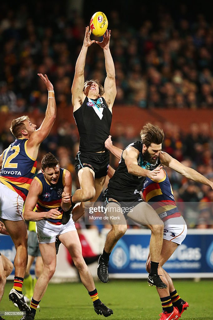 Jesse Palmer of the Power takes a mark during the round 22 AFL match between the Port Adelaide Power and the Adelaide Crows at Adelaide Oval on August 20, 2016 in Adelaide, Australia.