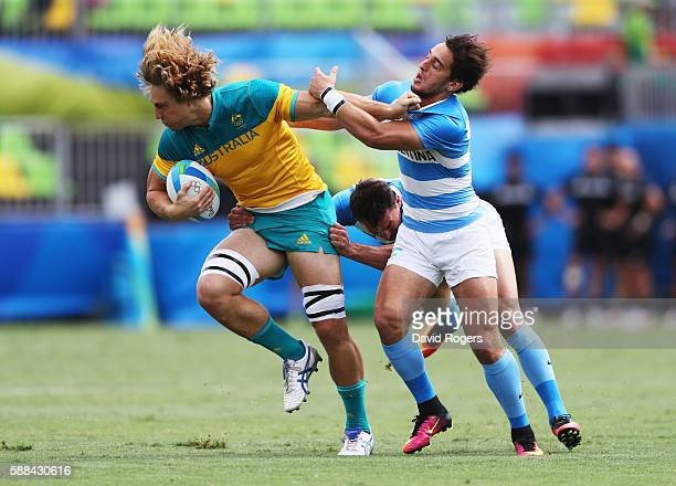 Jesse Parahi of Australia holds off Bautista Ezcurra of Argentina during the Men's Rugby Sevens placing 58 match between Argentina and Australia on...