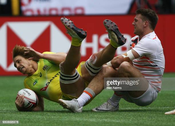 Jesse Parahi of Australia is tackled by Lachie Anderson of England during the Canada Sevens the Sixth round of the HSBC Sevens World Series at the BC...