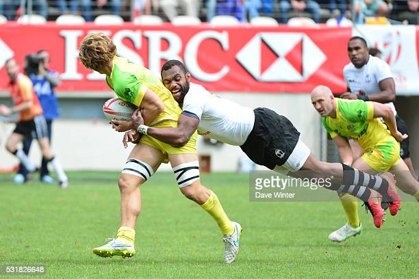 Jesse Parahi of Australia is tackled by Leone Nakarawa of Fiji during the HSBC PARIS SEVENS tournament at Stade Jean Bouin on May 15 2016 in Paris...