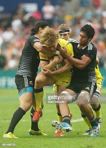 Jesse Parahi of Australia is tackled during the Cup semifinal match between Australia and New Zealand during day three of the 2014 Hong Kong Sevens...