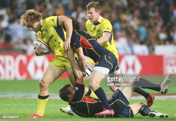 Jesse Parahi of Australia is tackled during the Pool B match between Australia and Spain during day one of the 2014 Hong Kong Sevens at Hong Kong...