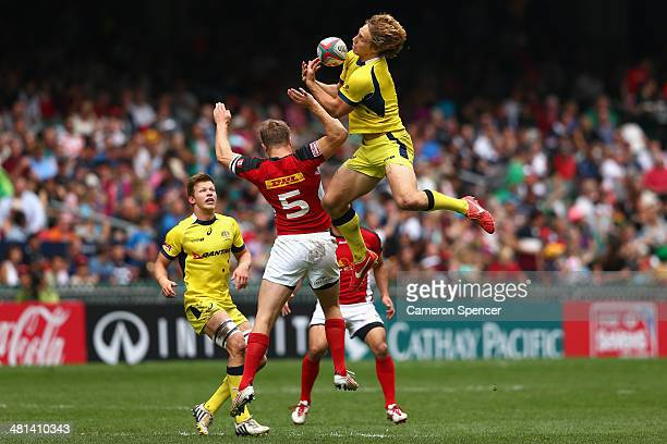 Jesse Parahi of Australia takes a high ball during the Cup quarterfinal match between Australia and Canada during the 2014 Hong Kong Sevens at Hong...