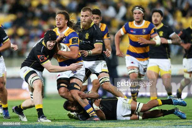 Jesse Parete of Bay of Plenty is tackled by James Blackwell of Wellington during the Mitre 10 Cup Championship Final match between Wellington and Bay...