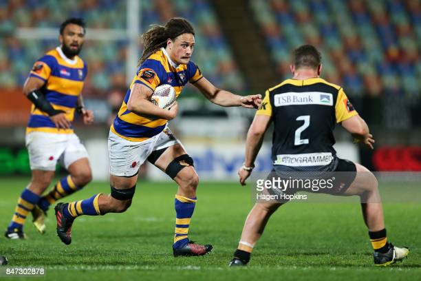 Jesse Parete of Bay of Plenty runs at Ricky Riccitelli of Taranaki during the round five Mitre 10 Cup match between Taranaki and Bay of Plenty at...