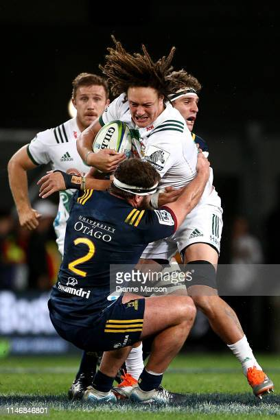 Jesse Parete of the Chiefs is tackled by Liam Coltman of the Highlanders during the Round 12 Super Rugby match between the Highlanders and the Chiefs...