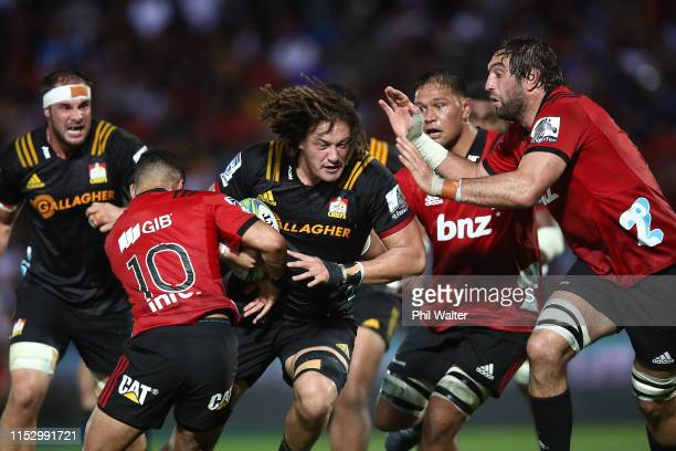 Jesse Parete of the Chiefs is tackled during the round 16 Super Rugby match between the Chiefs and the Crusaders at the ANZ National Stadium on June...