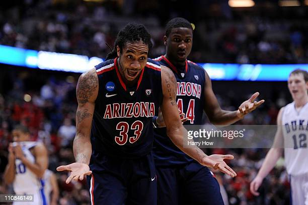 Jesse Perry and Solomon Hill of the Arizona Wildcats react after a play against the Duke Blue Devils during the west regional semifinal of the 2011...