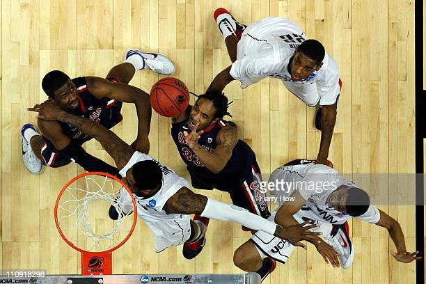 Jesse Perry of the Arizona Wildcats goes to the basket against Alex Oriakhi Roscoe Smith and Jeremy Lamb of the Connecticut Huskies during the west...