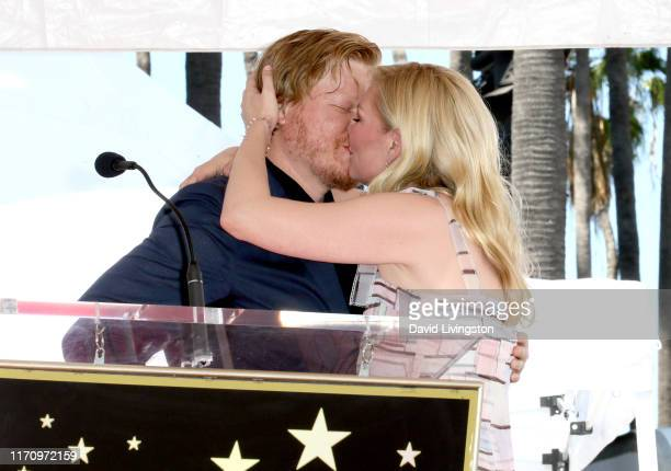 Jesse Plemons and Kirsten Dunst kiss during the ceremony honoring Kirsten Dunst with a star on the Hollywood Walk of Fame on August 29 2019 in...