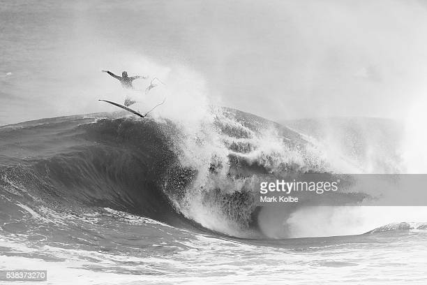Jesse Pollock of Australia dives off the back of a wave competes during the Red Bull Cape Fear surfing event at Cape Solander Kamay Botany Bay...
