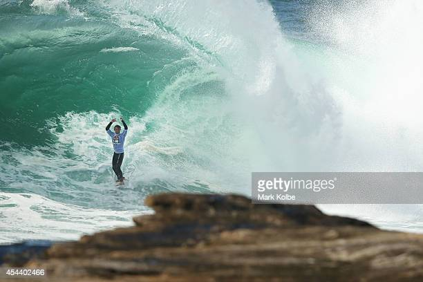 Jesse Polock of Australia celebrates a wave during the Red Bull Cape Fear surfing event at Cape Solander in Kamay Botany Bay National Park on August...