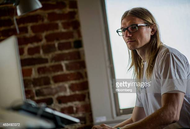 Jesse Powell chief executive officer of Kraken Bitcoin Exchange works on his computer at the company's office in San Francisco California US on...