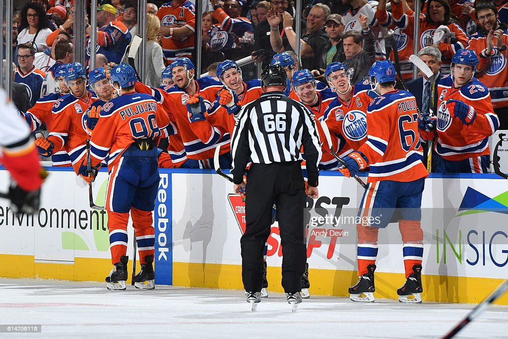 Jesse Puljujarvi #98 and Benoit Pouliot #67 of the Edmonton Oilers celebrate with team mates after a goal during the season opener against the Calgary Flames on October 12, 2016 at Rogers Place in Edmonton, Alberta, Canada